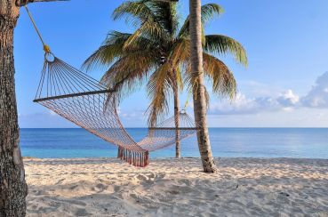 363629-hammock-on-the-beach-in-the-resort-of-guardalavaca-cuba_0.jpg